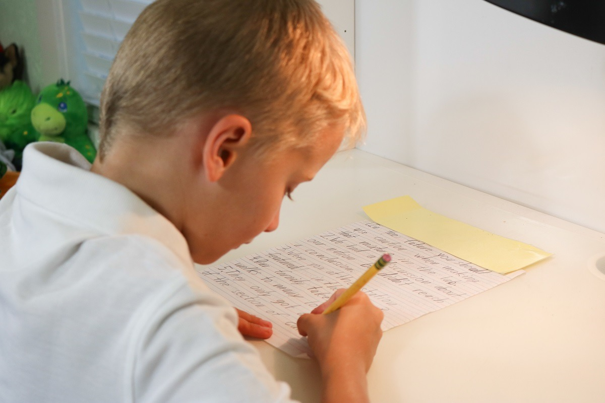 Boy practising for the 11 plus papers